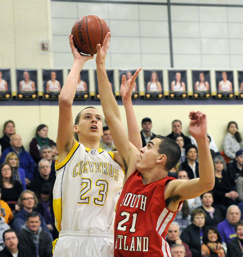 Matt Cimino, the 6-foot-9 center for Cheverus, attempts to loft a shot over Logan Gaddar of South Portland during Cheverus 50-35 win Friday night. The Stags will take an 18-0 record into the tournament.