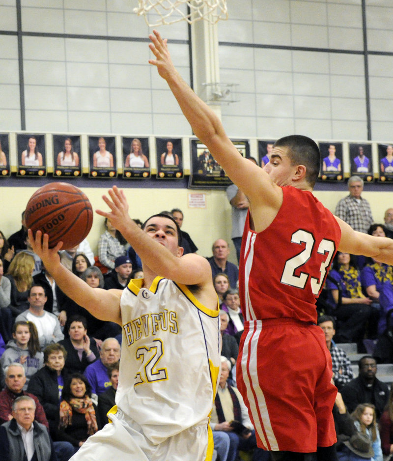 Joe Savino of Cheverus finds room to get off a shot while guarded by Vukasin Vignjevic of South Portland.