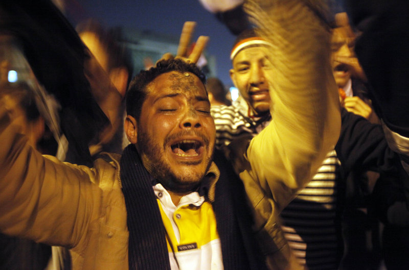 """Joy erupts in Cairo's Tahrir Square as President Hosni Mubarak steps down Friday evening. """"The Egyptian revolution could be a huge defeat or a huge victory for al-Qaida,"""" said Kenneth Pollack, director of the Brookings Institution's Saban Center for Middle East Policy."""