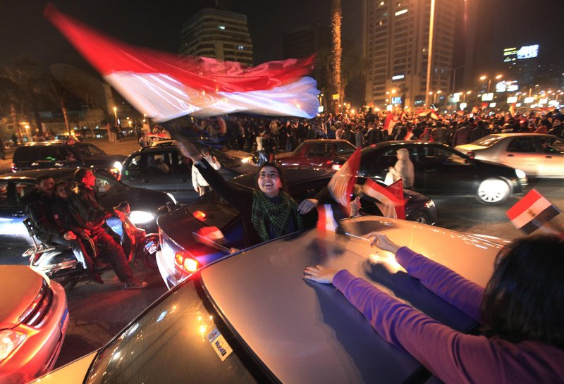 Egyptians thronged Tahrir Square in Cairo, waving flags and chanting slogans after President Hosni Mubarak resigned and handed power to the military Friday.