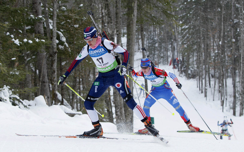 Sara Studebaker stays ahead of Russian Ekaterina Glazyrina on an uphill section of the course. Studebaker became the only U.S. biathlete to qualify for today's mass start.
