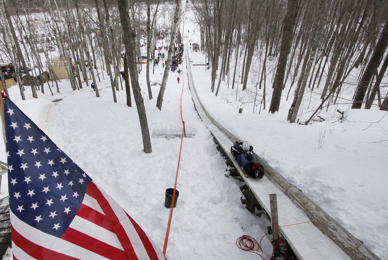 A team makes a trial run during the 21st Annual U.S. National Toboggan Championships in Camden on Saturday. The championships will continue through today.