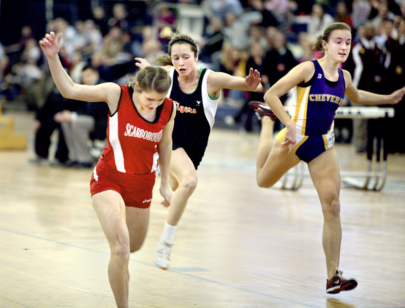 Nicole Kirk of Scarborough stretches to win the senior 40 in 5.38 seconds. Maria Curit of Biddeford, center, was fourth and Caroline Summa of Cheverus was fifth.