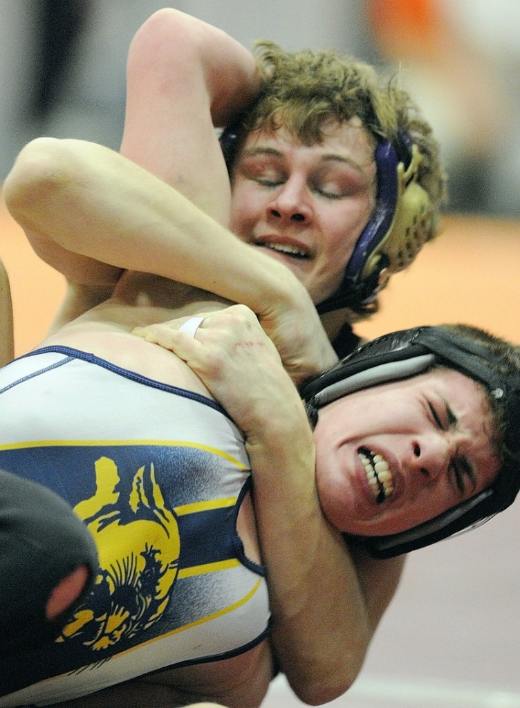 William Bellottie, top, of Marshwood and Kevin Moore of Mt. Blue compete Saturday in a 125-pound semifinal during the Class A wrestling championships at the Augusta Civic Center. Bellottie won, 13-4.