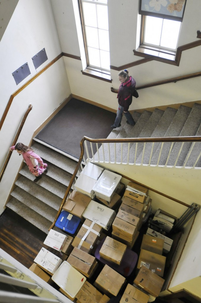 Boxes are stacked in the halls of the Clifford school as visitors walk around during the open house Sunday.