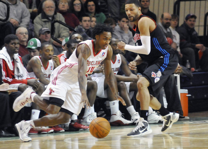 Jamar Smith moves to the basket around Tony Bobbitt of Springfield on Sunday. Smith scored 20 points as the Red Claws beat the Armor, 97-96.
