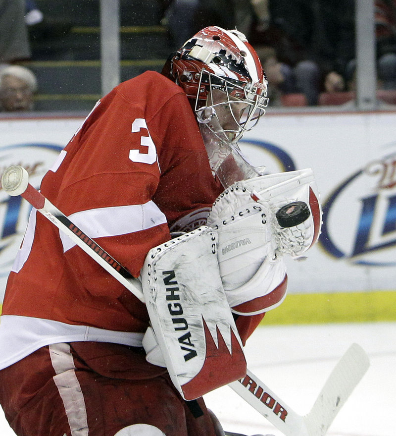 Jimmy Howard made 23 saves Sunday to lead Detroit to a 4-2 over Boston. Howard, the former UMaine goalie, is 27-10-3 with a 2.85 goals against average this season.
