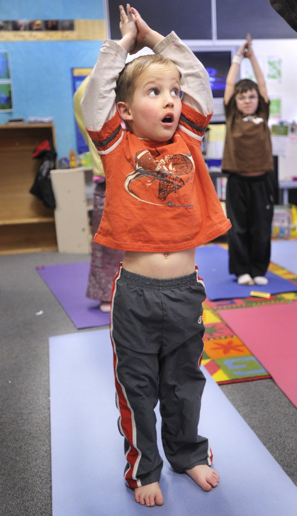 Student Jonathan Bouchard participates in a yoga class at Riverton School as part of an enrichment program. In March, students will present projects done during the program.