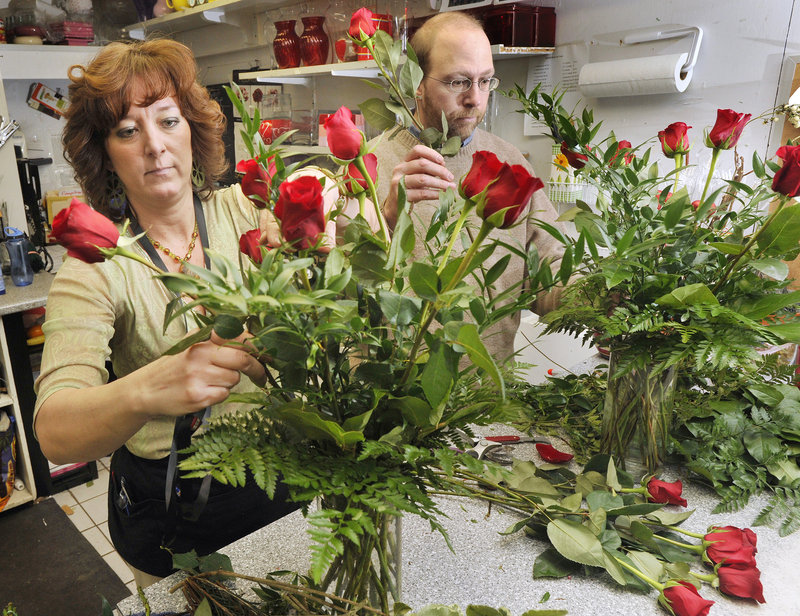 Reporter Ray Routhier gets some flower arranging tips from Rhonda Davis at Harmon's & Barton's.