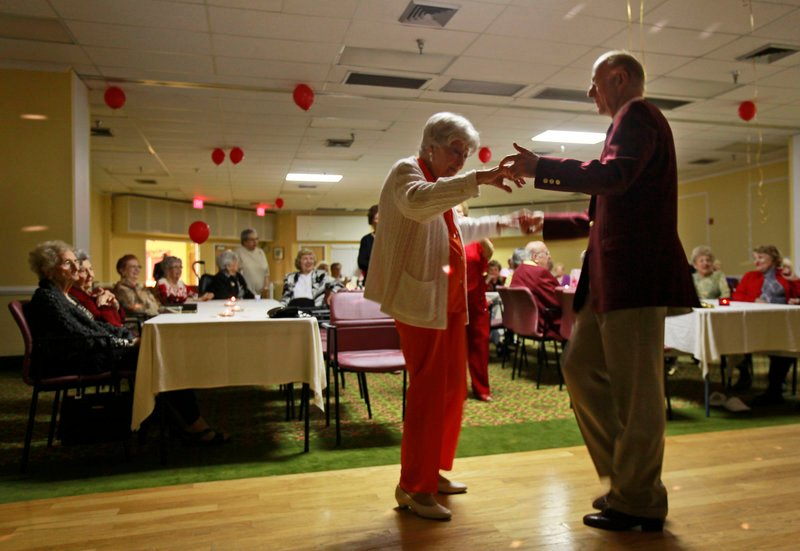 Hewitt Bruce dances with Betty Fisch at Edgewater Pointe Estates in Boca Raton, Fla. Women often so outnumber men in retirement communities that Valentine's Day can be a lonely time. A solution to the perennial shortage of men at dances: importing them.