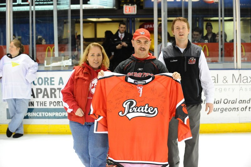David Blake was the winner of the Portland Pirates autographed American Heart Association jersey on Saturday night. Blake won the grand prize as part of the heart association's Mystery Pucks Contest. Blake, middle, a heart disease survivor, is pictured with Carrie Fortino, executive director of the American Heart Association of Maine, and Todd Jamison, director of corporate sales for the Pirates.