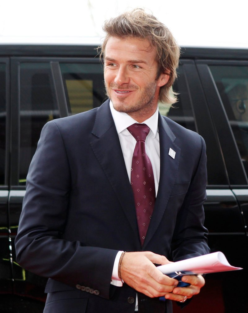 An attorney for soccer star David Beckham, above, vows to appeal a judge's dismissal of a lawsuit over a magazine story that claimed that Beckham cheated on his wife with a prostitute.