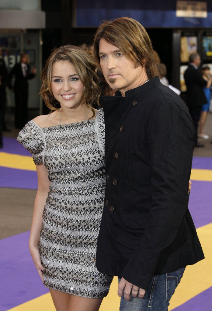 """Singer and actress Miley Cyrus and her father, musician Billy Ray Cyrus, are seen at the London premiere of the """"Hannah Montana"""" film in 2009."""