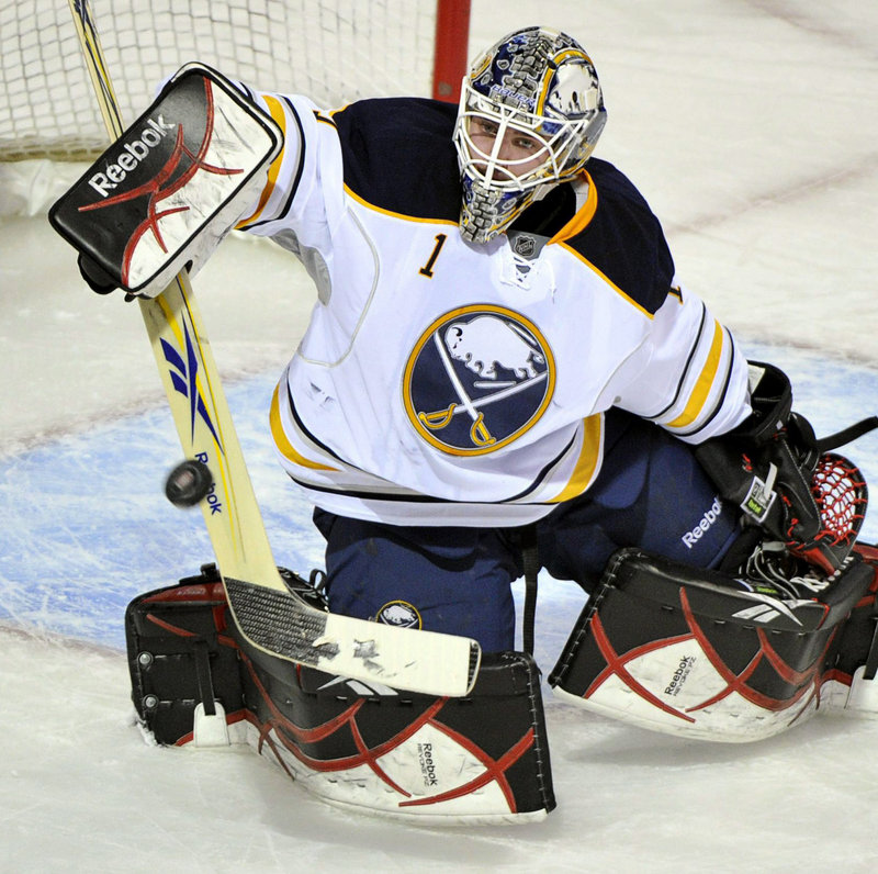 Jhonas Enroth, recalled from the Portland Pirates for the third time this season by Buffalo, makes one of his 32 saves as the Sabres beat Montreal in a shootout.