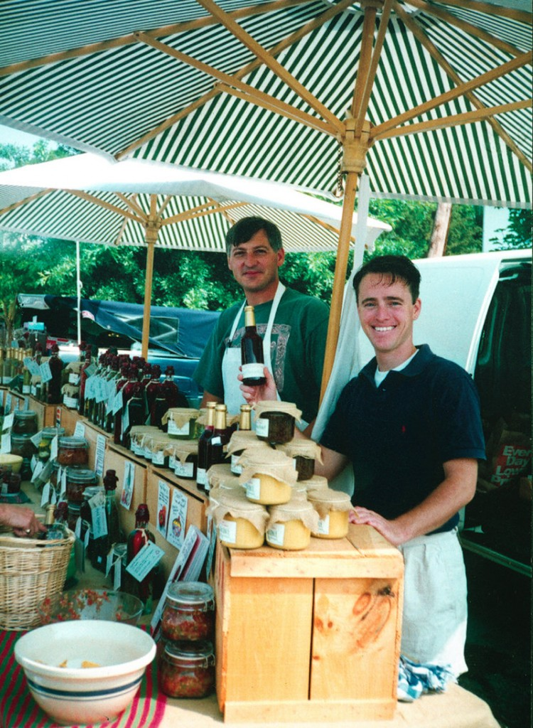 Jim Stott, left, and Jonathan King sell sauces on opening day at a farmer's market in 1991, the start of Stonewall Kitchen.