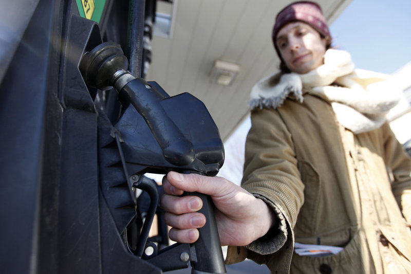 David Castro-Diephouse returns the nozzle to the pump after filling his car's tank with gas last week in Philadelphia. Gas prices reached a 28-month high last Wednesday amid escalating violence in the Middle East, even though oil and gas supplies in the United States continue to grow and demand for gas is weak.