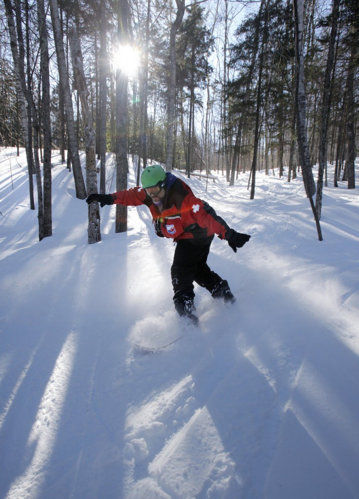 Steve Pixley snowboards in a glade at Camden Snow Bowl earlier this month. Pixley is a member of the ski patrol at the mountain.