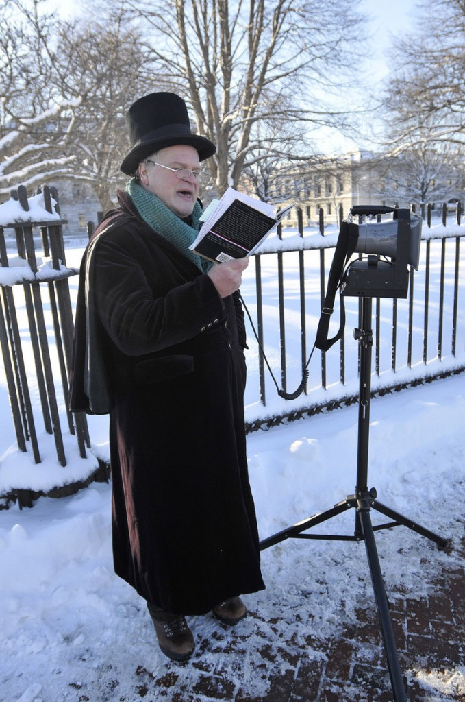Daniel Noel reads from Longfellow's works at the start of the Longfellow February Frostbite 2.5 K Road Race on Saturday.