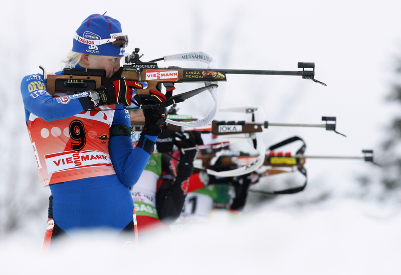 Kaisa Makaraine of Finland and other competitors take aim on the shooting range during the women's 10K pursuit at the biathlon World Cup event Sunday in Presque Isle.
