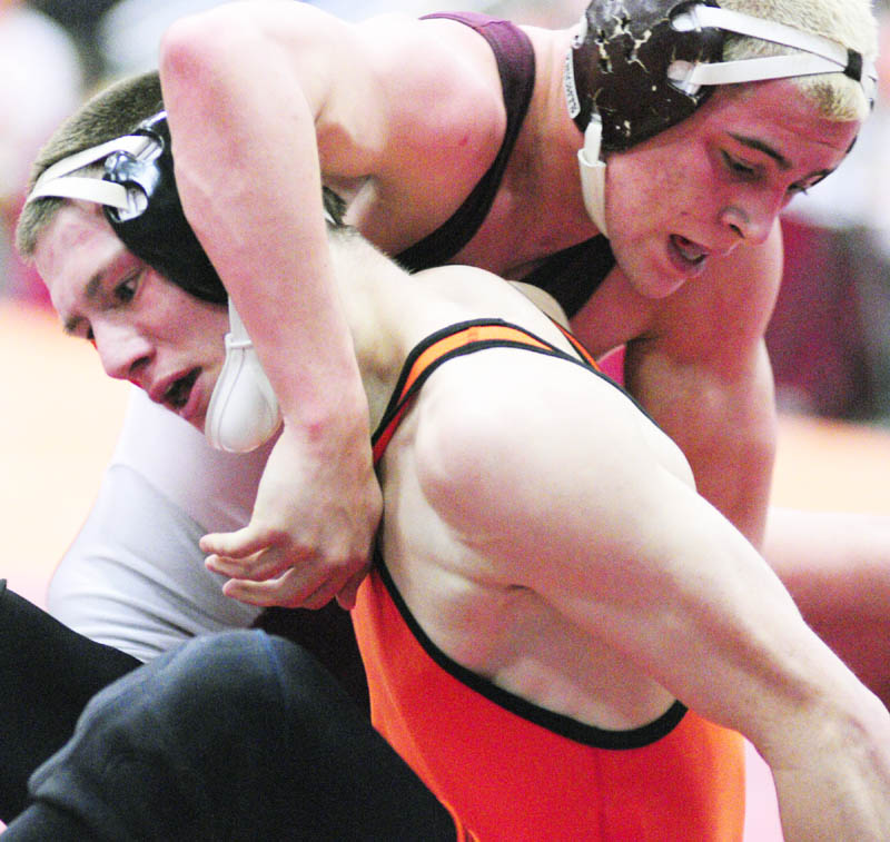 BATTLE IT OUT: Skowhegan's Kaleb Austin, bottom left, grapples with Noble's Ben Valencia in the 140-pound Class A championship match Saturday night during the wrestling state championships in the Augusta Civic Center. Valencia pinned Austin to win the title.