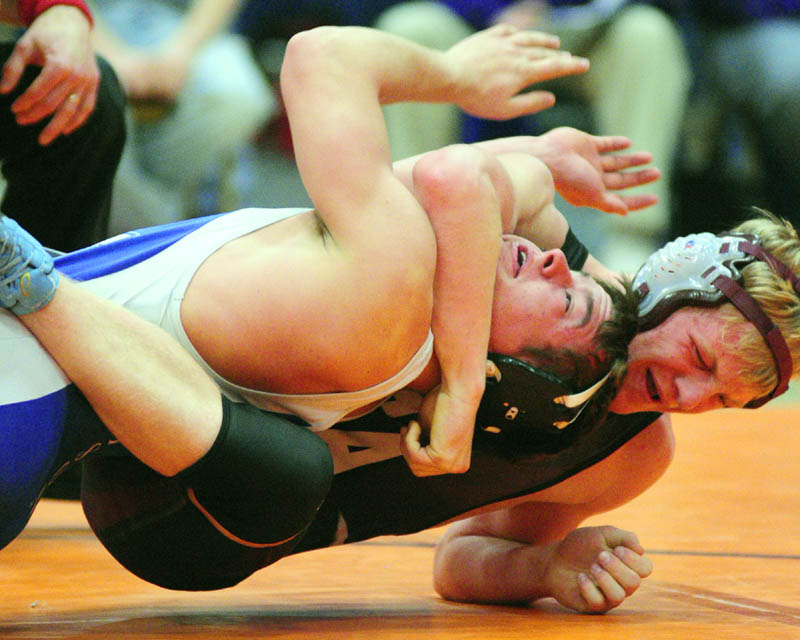 TOUGH SPOT: Madison's Jacob Campbell, left, and Foxcroft Academy's Wesley Stinson grapple in the 152-pound Class C championship match on Saturday night during the wrestling state championships at the Augusta Civic Center.