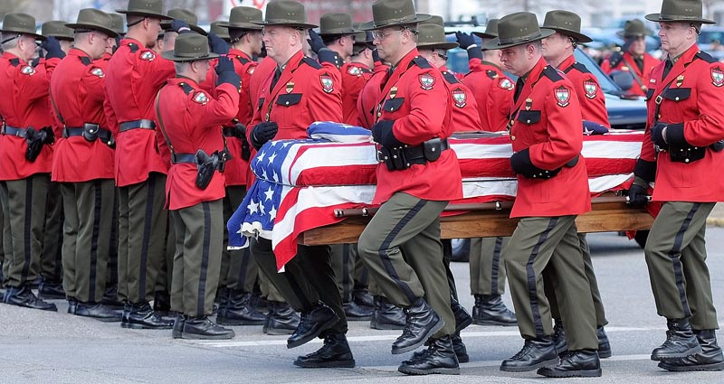 Maine Game Warden pall bearers carry the casket of Warden Service Pilot Daryl R. Gordon from the hearse into the Augusta Civic Center at the start of celebration of his life this afternoon.