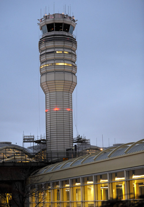 The FAA control tower at Reagan National Airport. Federal safety officials are investigating a report that two planes landed at the airport without control tower clearance because the air traffic controller was asleep.