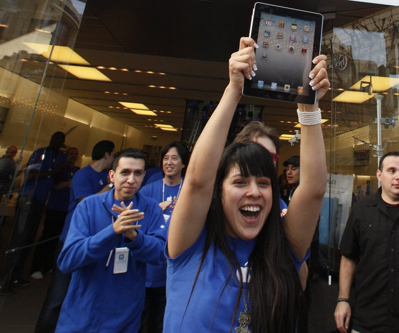 Apple employees cheer as the iPad 2 goes on sale at The Grove Apple store in Los Angeles on Friday. The iPad 2 is the updated version of Apple Inc.'s iPad tablet computer.
