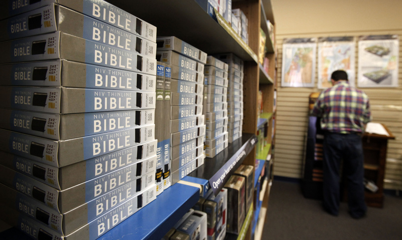 Copies of the New International Version Bible are displayed in a bookstore in Nashville, Tenn., on Thursday. It has been criticized by some conservatives, who say it may alter the original theological message.