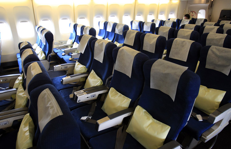 Seats are almost empty in a flight bound for Tokyo from Kimpo, South Korea, on Tuesday. Images broadcast worldwide of Japan's crippled nuclear complex and reports of food and water contaminated by radiation have battered its reputation as a safe destination, triggering an avalanche of cancellations by foreign tourists.