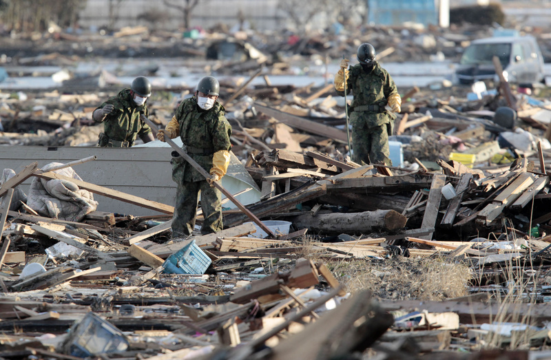 Japan Ground Self-Defense Force personnel search the rubble in the aftermath of the March 11 earthquake-triggered tsunami at Natori, Miyagi Prefecture, Japan, on Wednesday. 9.0 Magnitude Earthquake,Destruction,Devastation,Disaster,Earthquake,people,person,Ruin,Sendai Earthquake and Tsunami