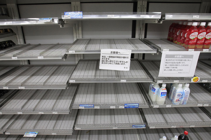 Shelves selling bottled water are empty at a convenience store in Tokyo today. A spike in radiation levels in Tokyo tap water have spurred new fears about food safety as rising black smoke forced another evacuation of workers trying to stabilize Japan's radiation-leaking nuclear plant. 9.0 Magnitude Earthquake; Destruction; Devastation; Disaster; Ea