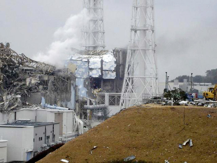 In this image released by Tokyo Electric Power Co., smoke billows from Unit 3, left, at the Fukushima Dai-ichi nuclear complex in Okumamachi, Fukushima Prefecture, northeastern Japan. At right is Unit 4. Japan welcomed U.S. help today in stabilizing its overheated, radiation-leaking nuclear complex, and reclassified the rating of the nuclear accident from Level 4 to Level 5 on a seven-level international scale, putting it on a par with the 1979 Three Mile Island accident.