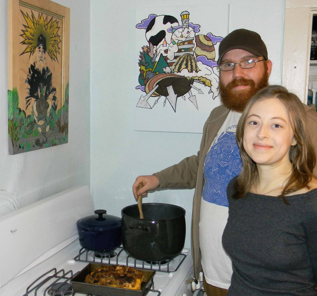 Luke Fuller and Cassi Madison prepare a chili using all Maine ingredients in their West End kitchen. For the past year, the recently engaged couple has made an effort to eat only food from Maine. Fuller, who is an artist, created the artwork above the stove. The piece on the left depicts the late Jim Cook, who founded the Crown O'Maine Organic Cooperative.
