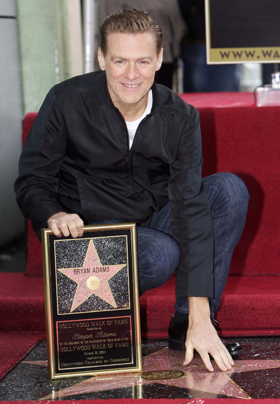 Canadian singer Bryan Adams is honored with a star on the Hollywood Walk of Fame on Monday.