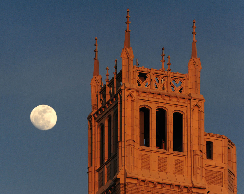 "The moon rises above the Jackson Building in Asheville, N.C., on Thursday. A so-called ""supermoon"" rises tonight."