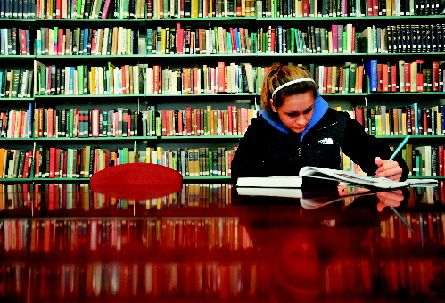 Thomas College sophomore Brianna Moore studies in the college library recently. The Harold Alfond Foundation announced today that it would pledge $5 million toward the college to help build a new academic center on campus with a new library, classrooms and more.