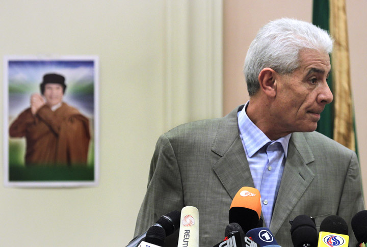 Libya's Foreign Minister Moussa Koussa reads a statement to foreign journalists at a hotel in Tripoli today.