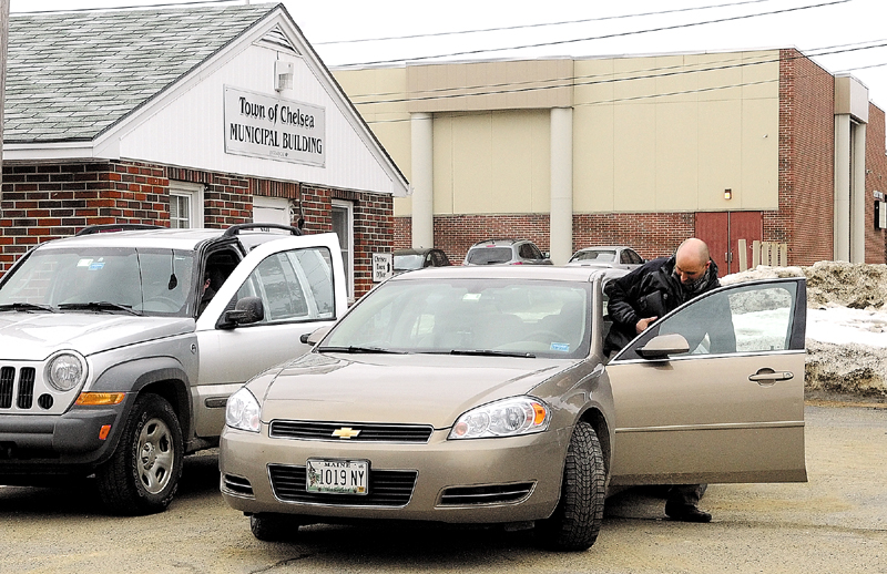 Investigators get into vehicles with boxes of impounded town records this morning at the Chelsea Town Office. Chelsea Selectman Mike Pushard and town attorney Steve Langsdorf said FBI agents were impounding the records.