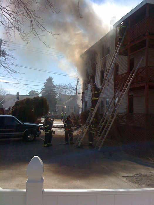Firefighters on the scene at 13 Walton St. in Portland today.