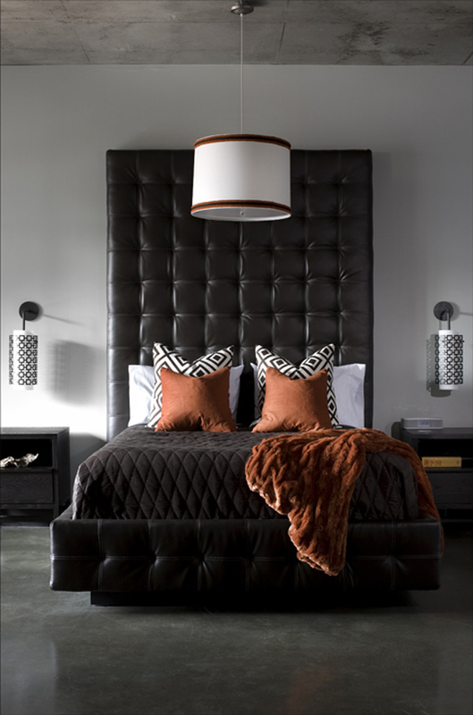To make industrial-style spaces cozy, Brian Patrick Flynn uses warm textiles and high-end upholstery techniques set against concrete floors and ceilings.