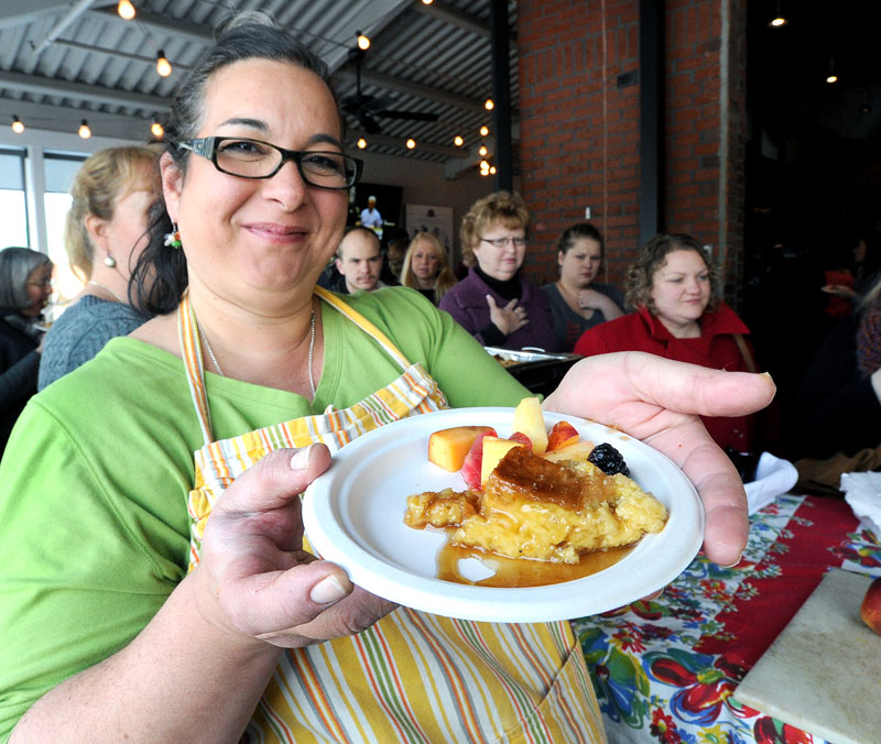 The Good Table's Lisa Kostopoulos serves a crème brulée french toast at the Second Annual Incredible Breakfast Cook-Off at the Sea Dog Brewing Co. in South Portland.