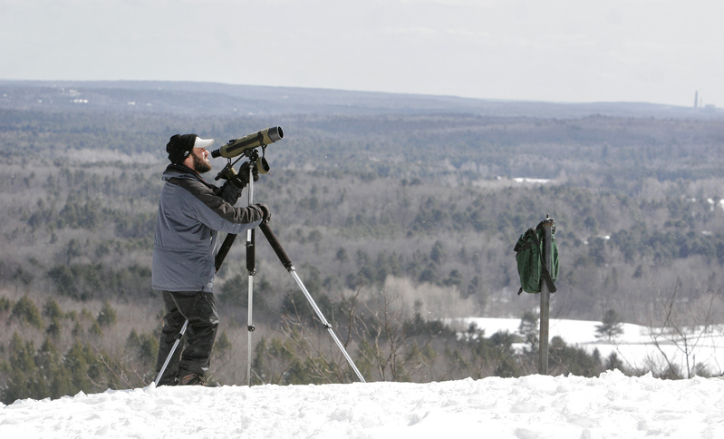Derek Lovitch of Freeport Wild Bird Supply looks for hawks atop Bradbury Mountain during a previous migration count. This year's spring hawk watch will begin Wednesday at the state park in Pownal. Freeport Wild Bird Supply team ups with Nikon Sport Optics to sponsor the project that collects valuable data while providing an enjoyable and educational experience for visitors. Andy Northrup, official counter this year, will be stationed at the Bradbury summit from 9 a.m. to 5 p.m. daily from Wednesday until May 15, and will be happy to answer questions about raptors. Observers are welcome to grab their binoculars and join the watch. Nikon also will provide binoculars for visitors to try out. The hawk watch is free, but there is an entry fee to the park: $3 for Maine residents ages 12-64; $1 for ages 5-11; free for those over 64 and under 5. Go online to www.freeportwildbirdsupply.com for more information.