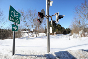 Old railroad lights sit idle where the Sebago to the Sea Trail ends for now in South Windham.