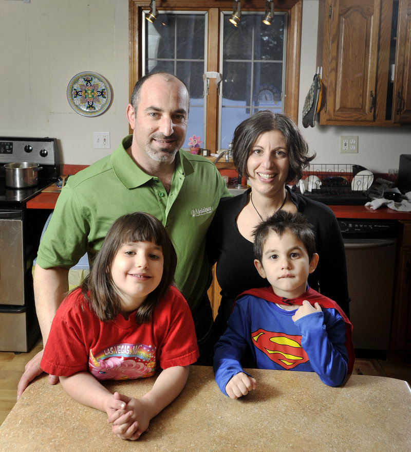 Gregg and Anat Levey, shown with Kaya, 6, and Aden, 4, say their smart meter led to insomnia and dizziness. The Leveys had CMP put the old analog meter back on their house in Falmouth. Meanwhile, company officials and regulators say there is no evidence of adverse effects from the meters' radio waves.