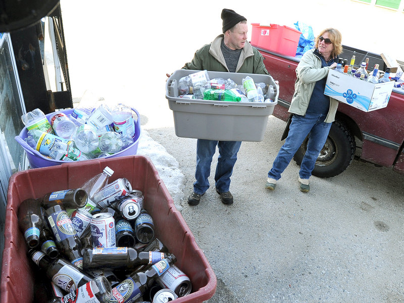 Dennis Mondville and Anne Maher of Cumberland unload returnables at the Yarmouth Beverage Redemption Center. Bottle bill critics disagree with suggestions that proposed changes in the law are part of the beverage industry's efforts to scuttle it.