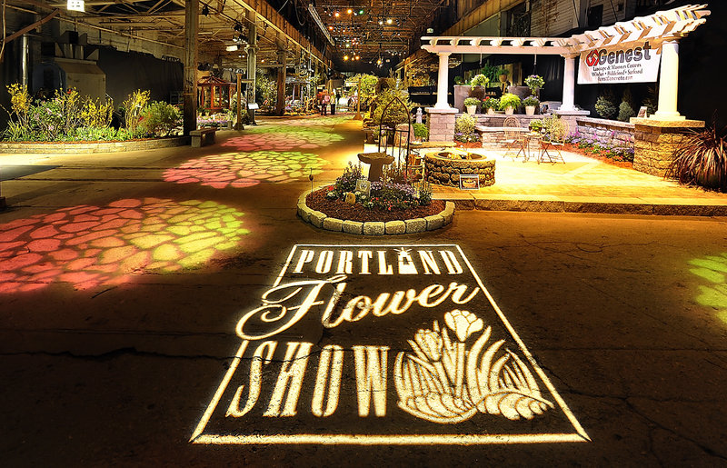 The grand entrance to the Portland Flower Show at the Portland Company Complex is enhanced by projected lighting.