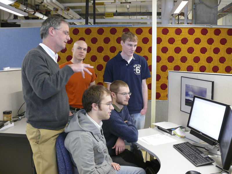Bruce MacLeod, a computer science professor at USM, works with students on mobile phone health care for the poor of Ghana and Nigeria. From left are MacLeod, Brent Atkinson of Hollis, Matt Blanchette of Scarborough, Brian Hartsock of Oakland and Dave Roberge of Auburn.