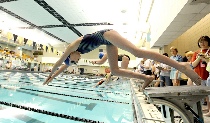 And into the pool she goes. Olivia Tighe of Coastal Maine Aquatics takes off to swim the first leg of the 400-yard freestyle relay.