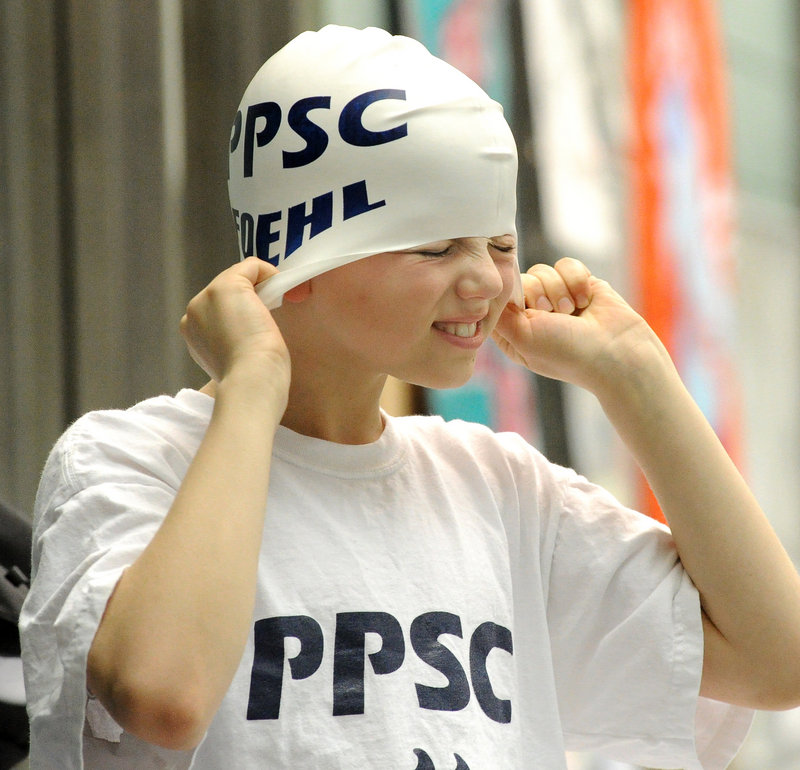 Reed Foehl, 10, of the Portland Porpoises grimaces while adjusting his cap. He finished fifth in the 50 breast stroke.